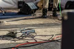 Guitar pedal vs tangled cables stock photography