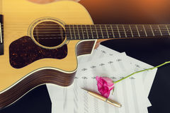Guitar with pen and rose on the note book,vintage filter. Stock Images