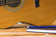 Guitar and pencil for create music Royalty Free Stock Images