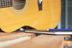 Guitar and pencil for create music Stock Photos