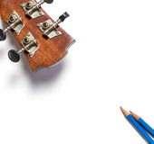 Guitar and Pencils song writing. Equipment Stock Photography