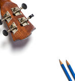 Guitar and Pencils song writing. Isolated on white Royalty Free Stock Photo