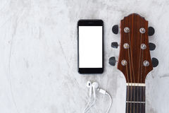Guitar and phone mobile white screen showing white screen top vi Royalty Free Stock Image