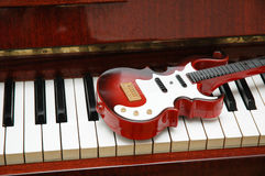 Guitar on the piano. Keys Stock Photography