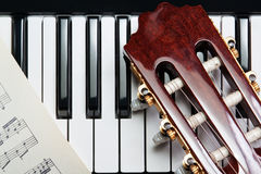 Guitar on the piano Royalty Free Stock Photography