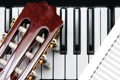 Guitar on the piano Stock Image
