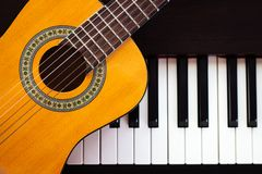 Guitar on piano. Classical music instrument royalty free stock photography