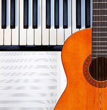 Guitar, piano and score. Stock Image