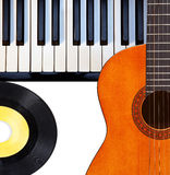 Guitar, piano and vinyl record. Stock Photo