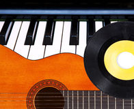 Guitar, piano and vinyl record. Royalty Free Stock Photography