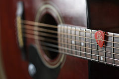 Guitar and pick Stock Images