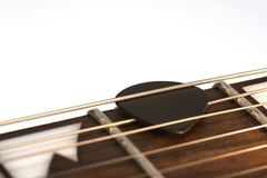 Guitar pick. Close-up of a guitar pick within the strings Royalty Free Stock Photo