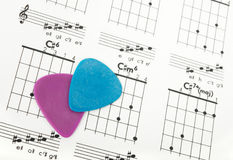Guitar picks on a chords chart Stock Photos