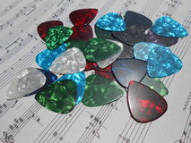 Guitar picks on the music notes Stock Photo