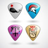Guitar picks or plectrums with custom designs Royalty Free Stock Photo