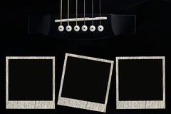 Guitar with picture frame Royalty Free Stock Photo