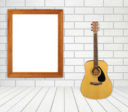 guitar and picture frame in room royalty free stock photo
