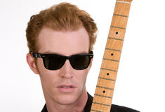 Guitar Player 1. A Guitar Player Dressed In Black Posing Royalty Free Stock Image