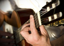 Guitar player. Closeup of an acoustic guitar player hands, playing a chord Stock Photos