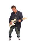 Guitar player. Man playing an electric guitar on a white background Stock Images