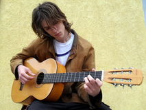 Guitar player. Sexy young man plays The guitr Stock Image