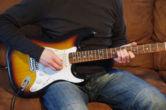 Guitar player. Rock / Blues guitar player. Focus on the guitar body Stock Photos
