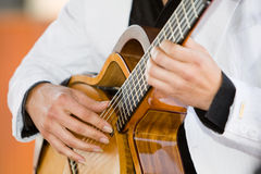 Guitar player. A horizontal photo of a caucasian musician playing a classical guitar at a wedding reception Stock Images