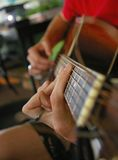 Guitar Player. Up close shot of hands playing a bar chord on a guitar Royalty Free Stock Photo