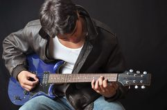 Guitar player. This picture represents a guitar player stock photography