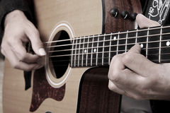 Guitar player. Hands of a guitar player with an acoustic guitar wood stock photos