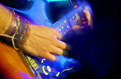 Guitar player. First plane of guitar player in live royalty free stock photo