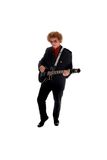 Guitar Player. Young man in a black suite playing guitar Stock Photos