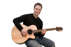 Guitar Player. Man with guitar on white background Royalty Free Stock Image