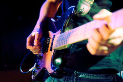 Guitar player. Close up image of guitar player on stage royalty free stock photos