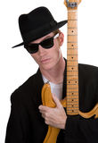 Guitar Player 3. A Guitar Player Dressed In Black Posing Stock Photography