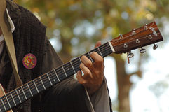 Guitar Player. A renaissance faire performer plays the guitar outdoors Stock Photography