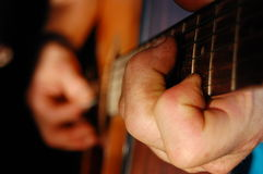 Guitar Player. Close-up of worn fingers playing the guitar Royalty Free Stock Photo