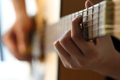 Guitar player. Learn to play guitar Royalty Free Stock Photo