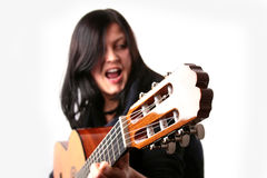 Guitar player. Photo of attractive brunette with guitar Royalty Free Stock Photography