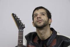 Guitar player. An Asian man with a guitar Royalty Free Stock Photography