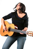 Guitar player. Photo of attractive brunette with guitar Stock Photography