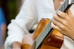 Guitar player. Playing a guitar Royalty Free Stock Images