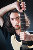 Guitar player against the dark Stock Photography