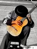 Guitar player with black hat Stock Photos