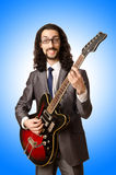 Guitar player in business suit Royalty Free Stock Photos