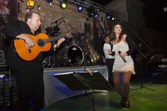 Guitar player and dancing singer Royalty Free Stock Image