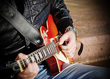 Guitar player with electric guitar Royalty Free Stock Photo