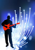 Guitar player on Fiber Optic Background.  Royalty Free Stock Image