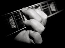 Guitar player fretboard playing chords black Stock Images