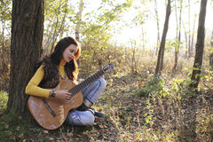 Guitar player girl Royalty Free Stock Photo